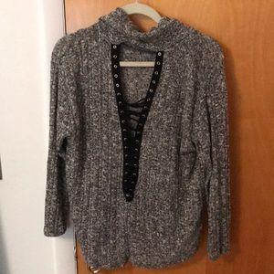 Turtleneck lightweight lace up sweater.